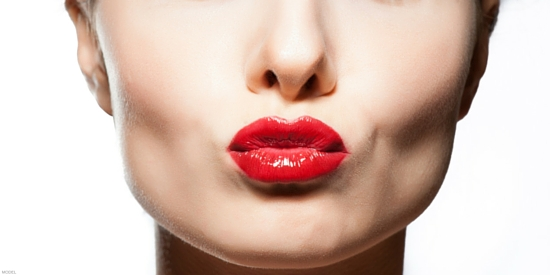 Woman with red lips making a kissing face