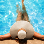 Woman swimming in pool after plastic surgery