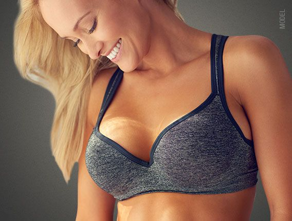 smiling blonde woman in sports bra